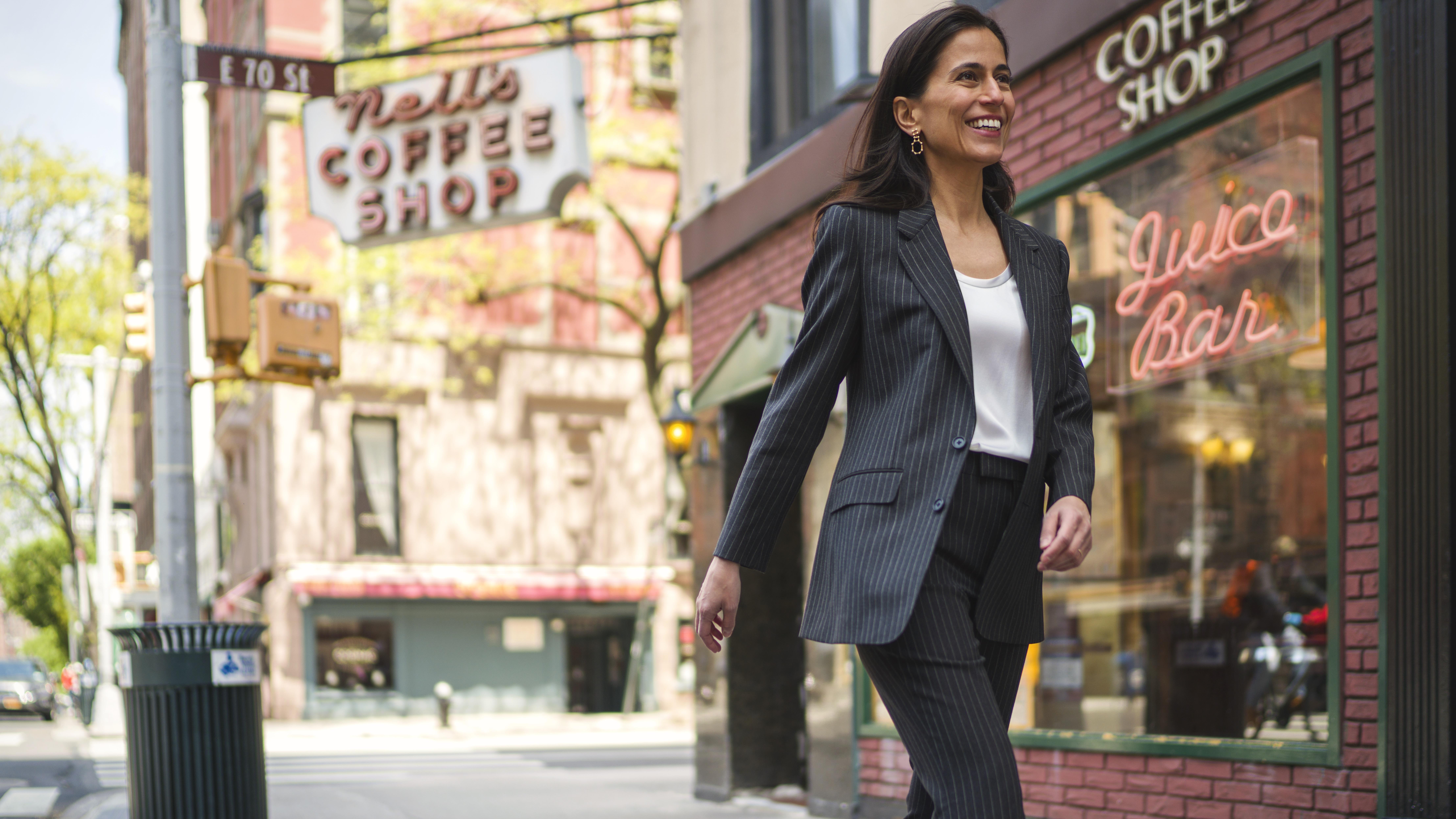 Farhadian Weinstein walking near coffee shop