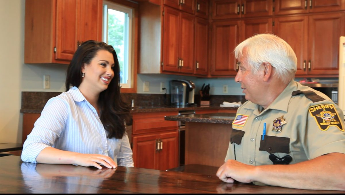 Julia Coleman speaks with sheriff