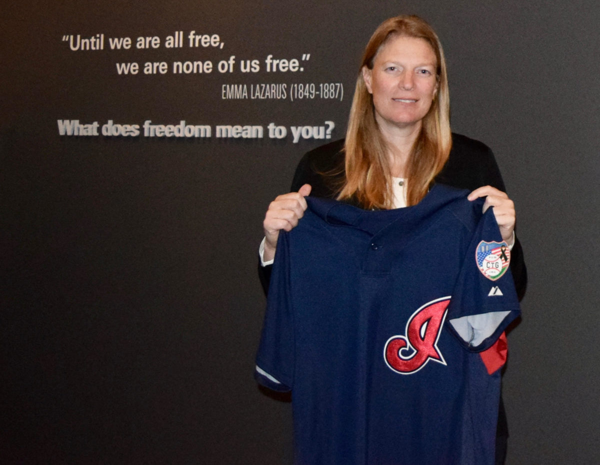 Justine Siegal holds jersey