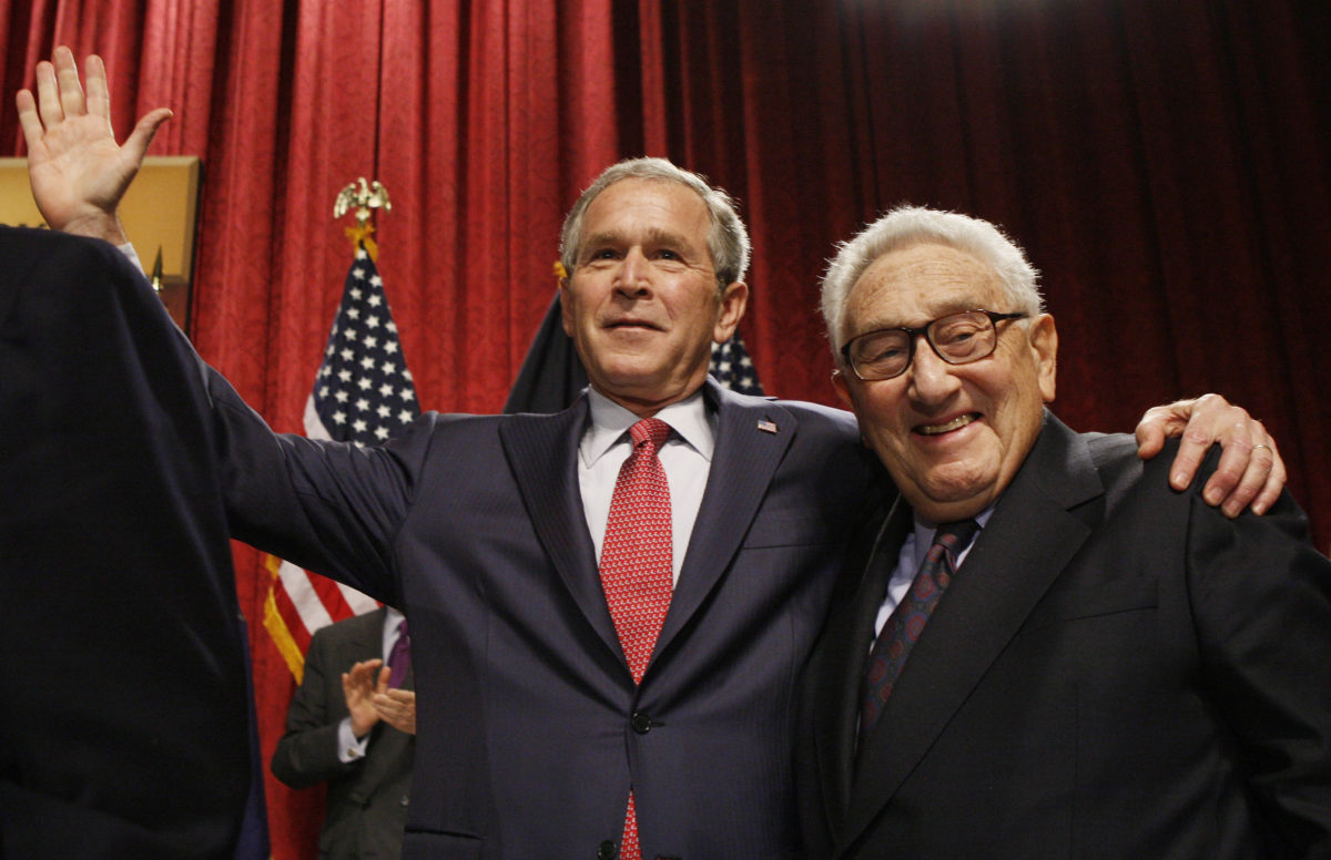 President Bush stands with former Secretary of State Henry Kissinger after the president spoke about the economy, Friday, March 14, 2008, during an address before The Economic Club of New York in New York. (Charles Dharapak/AP)
