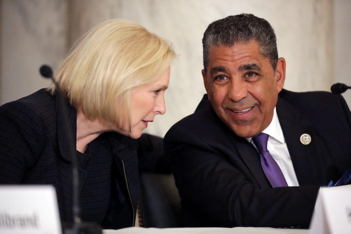 Sen. Kirsten Gillibrand (D-NY) talks with Rep. Adriano Espaillat (D-NY) during a post-midterm election meeting of Rev. Al Sharpton's National Action Network in the Kennedy Caucus Room at the Russell Senate Office Building on Capitol Hill November 14, 2018 in Washington, DC.  (Chip Somodevilla/Getty Images)